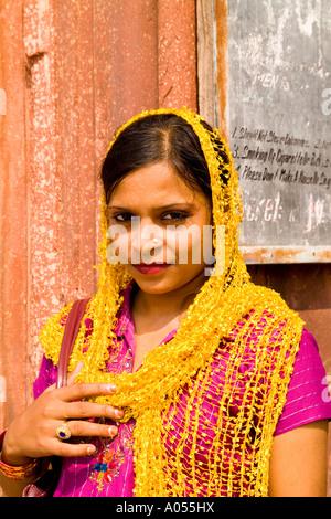Woman in colorful costume sari in Old Delhi India - Stock Photo