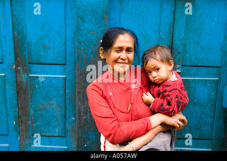 Woman local with grand child in arms in village of Bhaktapur a town near Kathmandu Nepal - Stock Photo