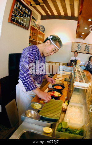 PARIS France, Interior 'Japanese Restaurant' 'Sushi Chef' in 'Isami Restaurant' Working in Kitchen Behind Counter - Stock Photo