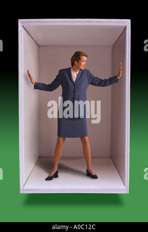 Businesswoman trapped in box - Stock Photo