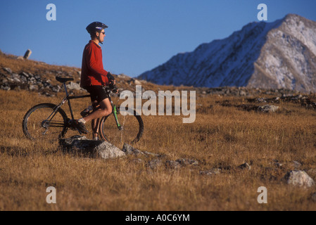 Mountain biker looking off in distance - Stock Photo