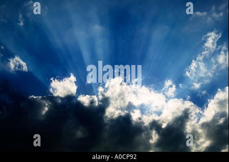Sun rays through clouds at Joshua Tree National Park California - Stock Photo