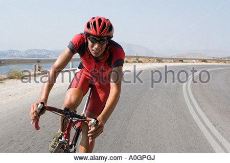 Cyclist on road - Stockfoto