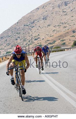 Cyclists on mountain road - Stockfoto