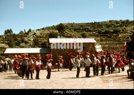 Peru Lake Titicaca Taquile Island dancers in square - Stock Photo