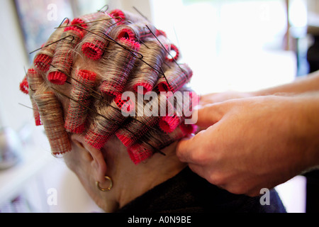 Lady 70s 80s at traditional hairdressers England UK - Stock Photo