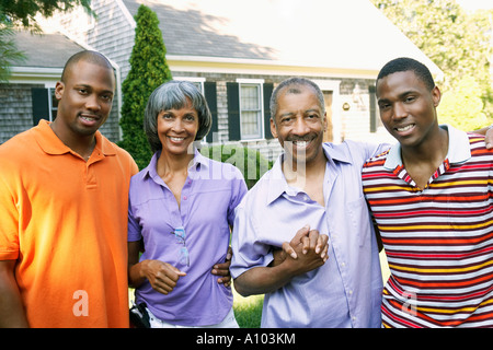 Members of African family smiling together - Stock Photo