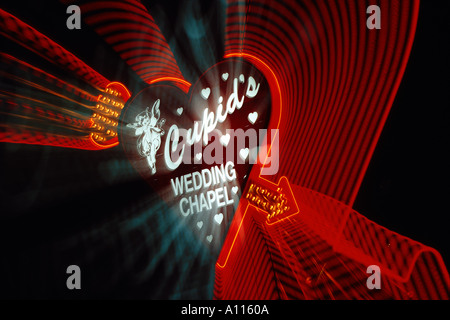 Zoomed view of neon sign at night Cupid s Wedding Chapel Las Vegas Nevada USA - Stock Photo