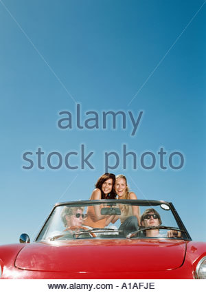Friends enjoying road trip - Stock Photo