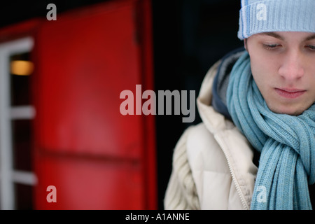 Sullen man in winter clothes - Stock Photo