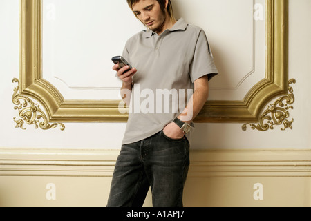 Man reading a text message - Stock Photo