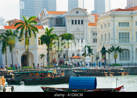 Boat Quay SINGAPORE Statue Sir Stamford Raffles riverside river side Landing Site famous place tourist seen from - Stock Photo