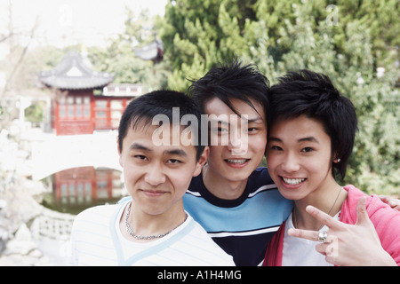 Portrait of a teenage boy and two young men - Stock Photo