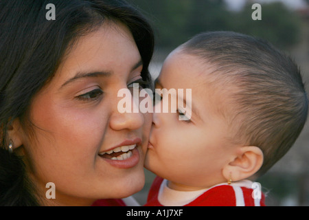 SSK76354 South Asian Indian girl child kissing her mother Model Relase Nos 592 593 - Stock Photo