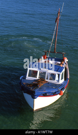 Manouvering pleasure boat in st ives cornwall harbour number 1866 - Stock Photo