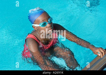 Children participate in a swim race - Stock Photo