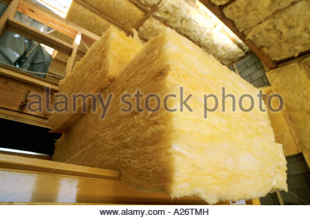 R38 Fiberglass Insulation being installed in roof in new loft style home under construction - Stock Photo