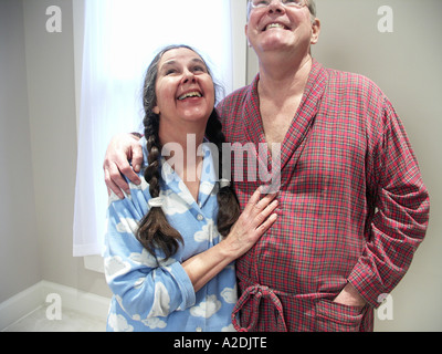 Middle Age Couple Enjoying the Morning - Stock Photo