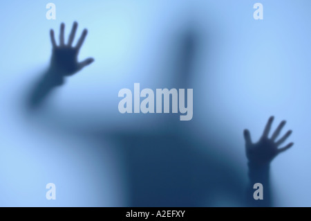 Person behind a frosted window - Stock Photo