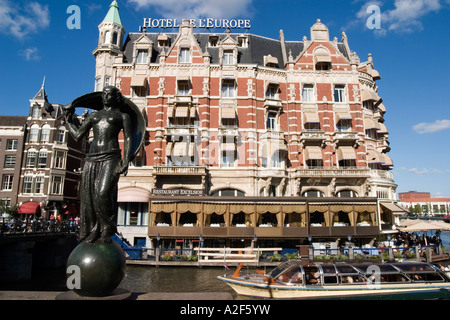 Amsterdam Hotel de l Europe canal sculpture canal boat Restaurant Exelsior Terasse - Stock Photo