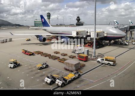 United Airlines 747 400 being serviced at Hong Kong International Airport Hong Kong SAR China Asia - Stock Photo