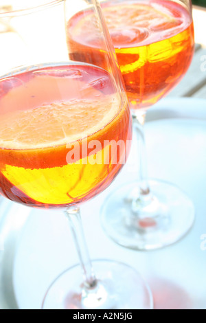 Close-up of two glasses of cocktails and slices of orange - Stock Photo