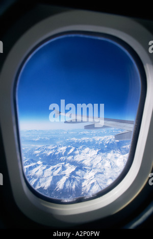 View of mountains from aeroplane window - Stock Photo
