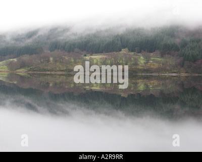 Fog hanging over the south shore of Loch Voil near Balquhidder - Stock Photo