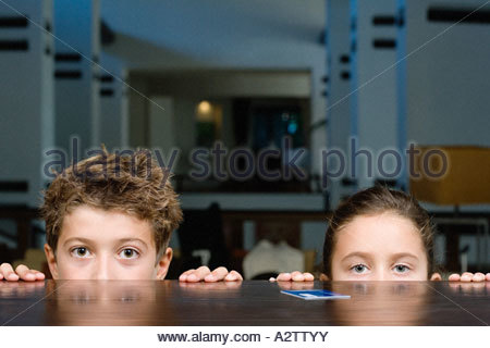 Children at reception counter - Stock Photo