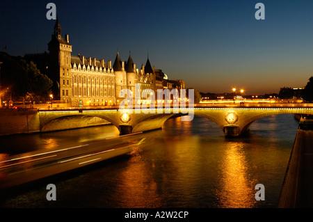 A view of the Conciergerie, on Ile de la Cite, and an iconic Parisian bridge; Paris, France. - Stock Photo