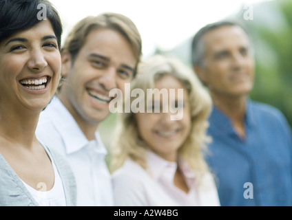 Mid-adult couple with mature couple, laughing - Stock Photo