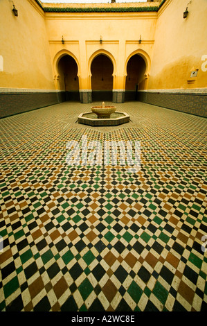 Antiquities Arched doorways and intricate tile work of the Mausoleum of Moulay Ismail Town of Meknes Morocco - Stock Photo