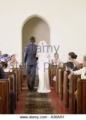 Bride and groom in church - Stock Photo