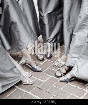 Bridesmaids standing with feet in a circle - Stock Photo