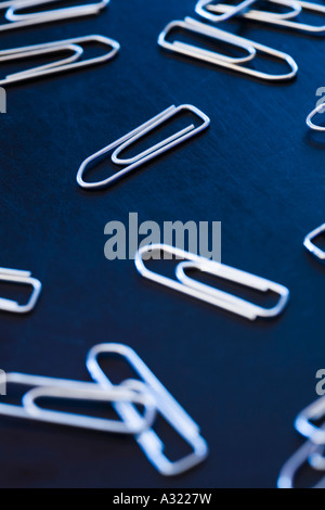 Group of paper clips on a desk - Stock Photo