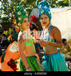 Two women dressed up in exotic bright clothes for a street carnival South Bank London England UK 2006 - Stock Photo