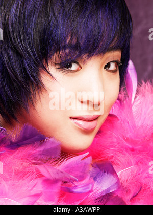 Asian ethnic model girl with black and blue trendy haircut looking into camera portrait - Stock Photo