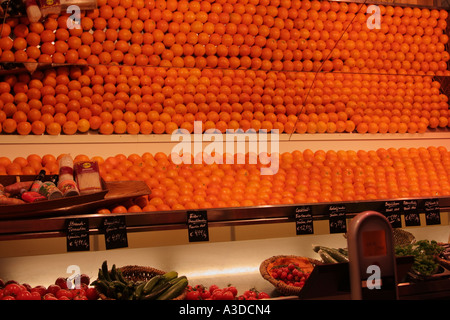 Oranges in line reflecting in mirror at fruit stall Munich Muenchen Bavaria Germany - Stock Photo