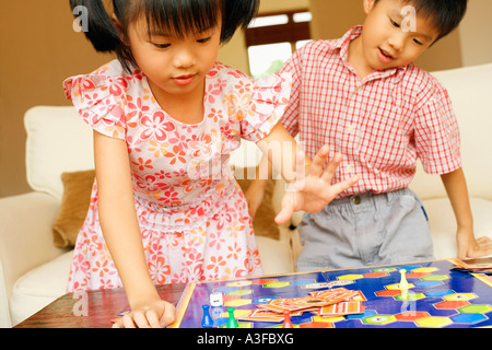 Close-up of a boy playing with his sister - Stock Photo