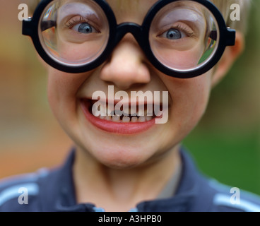 Young boy wearing joke glasses - Stock Photo
