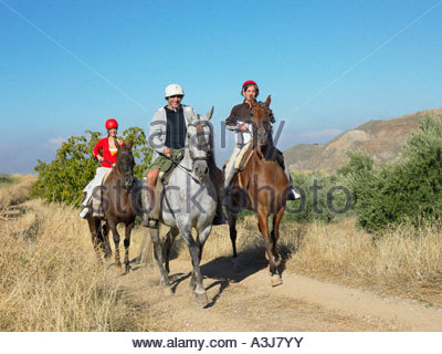 Three friends riding horses - Stock Photo