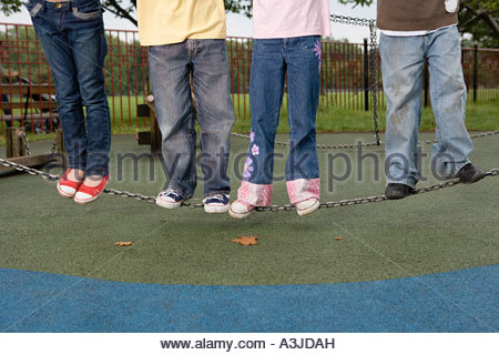Children standing on a chain - Stock Photo