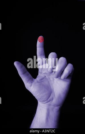 Hand with target bulls eye bullseye on finger pointed - Stock Photo