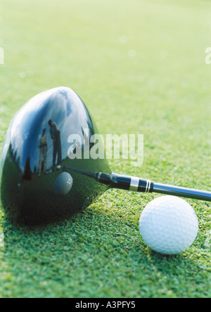 Golf ball and club, close-up - Stock Photo