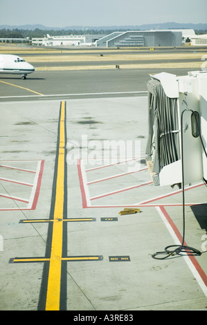 Commercial airliner pulling into gate at Portland International Airport PDX in Oregon - Stock Photo