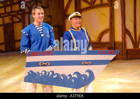 two amateur actors on stage performing in Dick Whittington pantomime Aberystwyth arts centre - Stock Photo