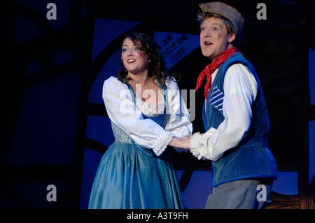 two amateur Actors on stage performing in Dick Whittington pantomime Aberystwyth arts centre Wales UK - Stock Photo