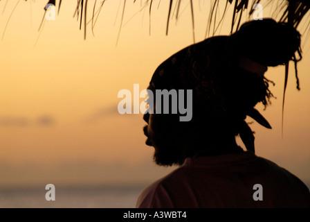 Rastafarian at sunset Negril Jamaica - Stock Photo