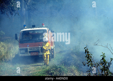 Volunteer Firefighter at a bushfire - Stock Photo