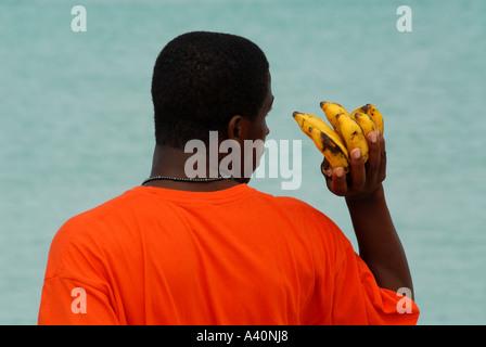 Man selling bananas Negril beach Jamaica - Stock Photo
